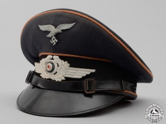 A Luftwaffe Signals (Nachtrichten) NCO/Enlisted Man's Visor Cap by WILLY RAST, NÜRNBERG