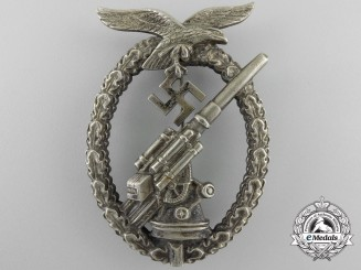 An Early Luftwaffe Flak Badge in Tombac with Ball Hinge