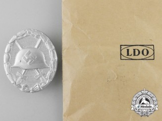 A Mint Silver Grade Wound Badge with Packet