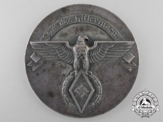 An HJ Service Achievement Award Table Medal