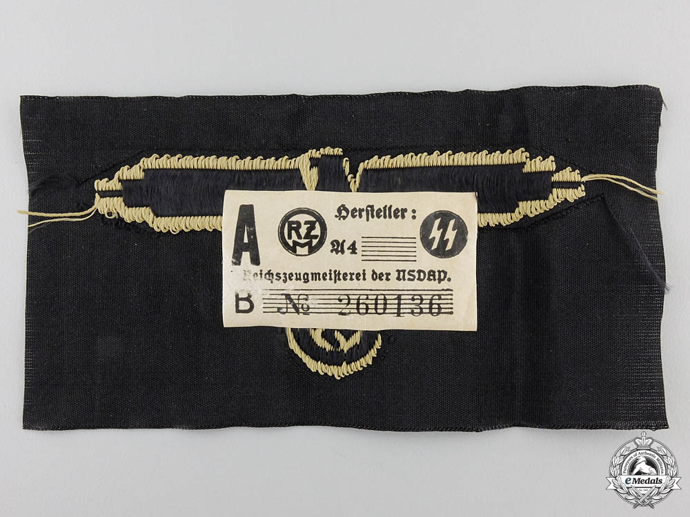 An SS Tropical Sleeve Insignia with Paper Label