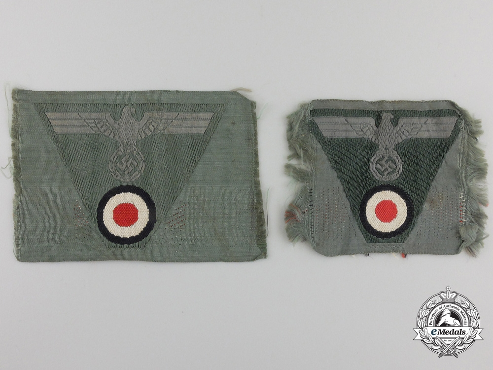 Two Wehrmacht Cap insignia