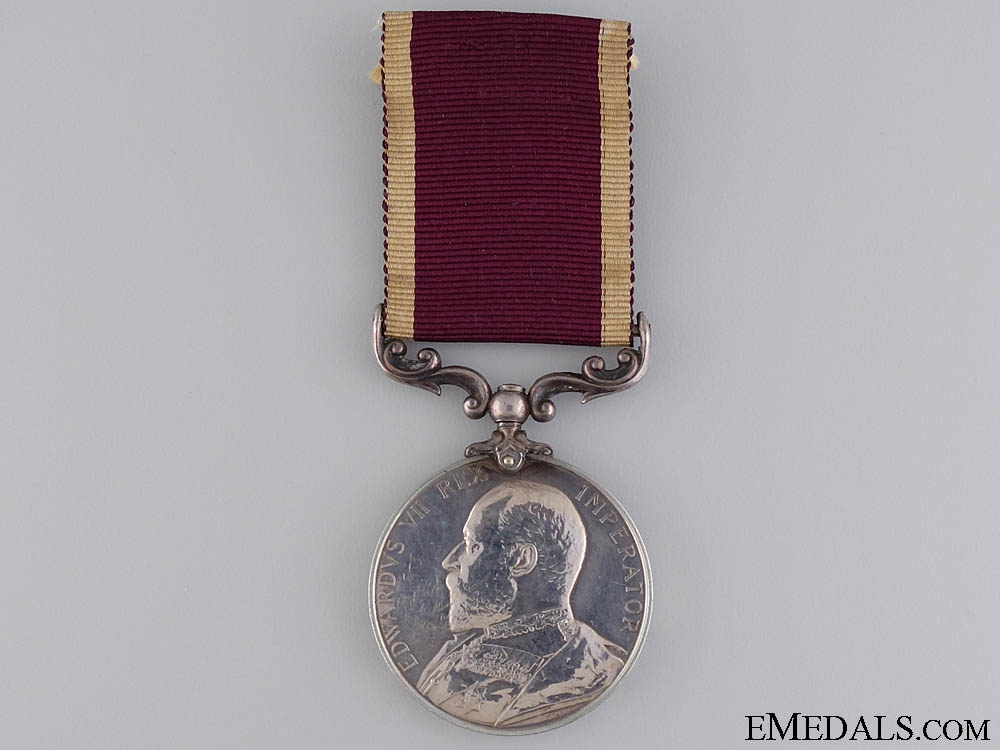 A Long Service & Good Conduct Medal to Company Sgt. Major