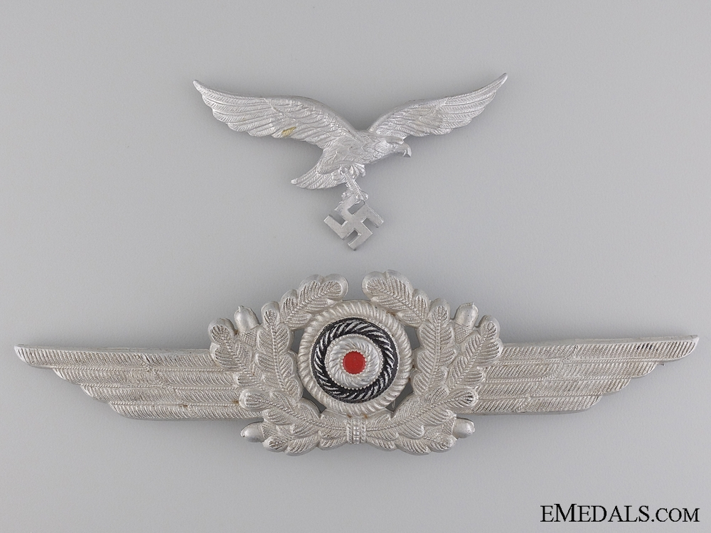 A Luftwaffe Visor Wreath with Cockade and Breast Eagle
