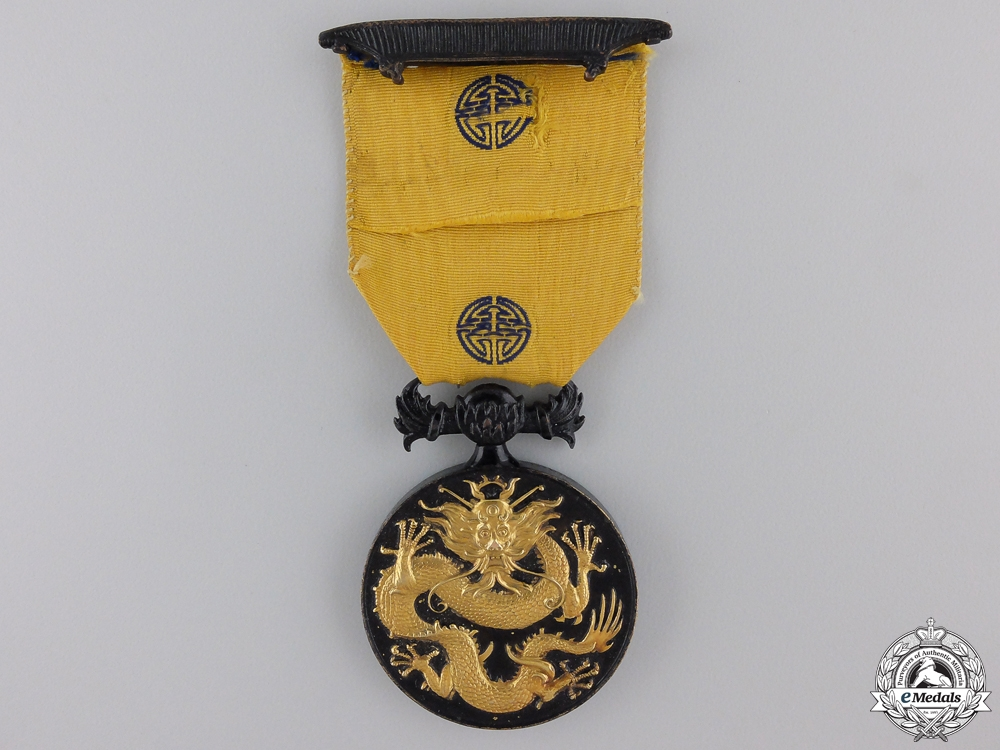 A Military Order of the Dragon to C.D.Brunce; Wounded at Tientsin