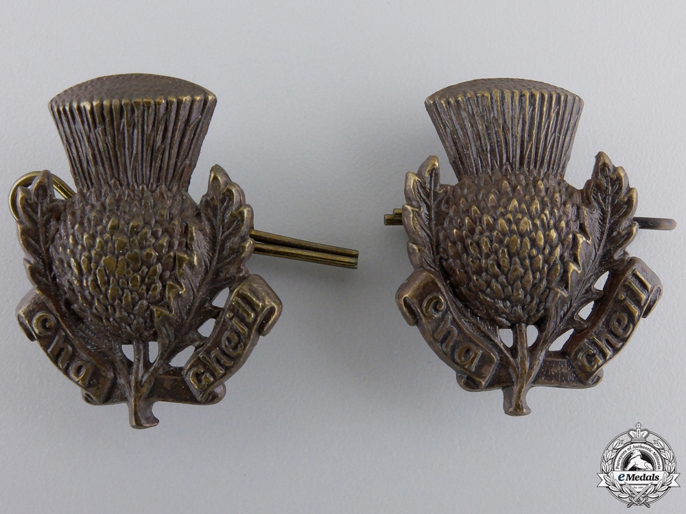 A Pair of Second War Queen's University COTC Collar Badges