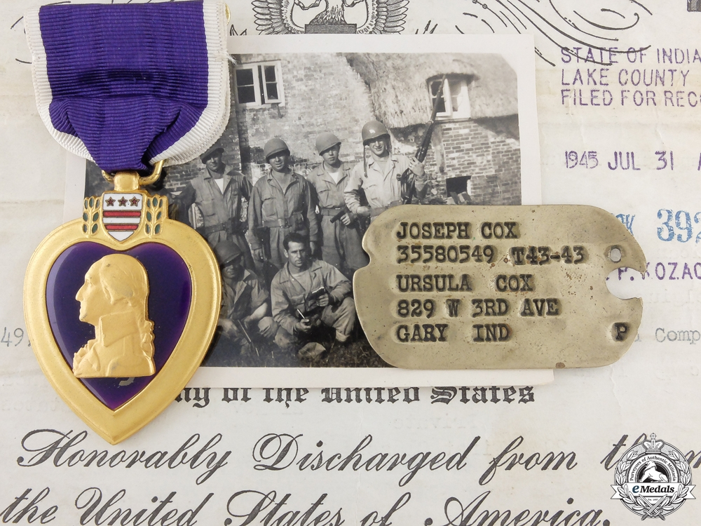 A Puprle Heart to Pte. Cox; Normandy Veteran Wounded in Belgium