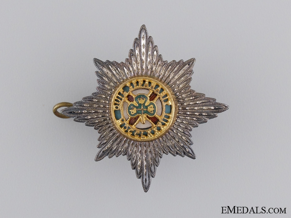 A Sterling Silver Irish Guards Officer's Cap Badge