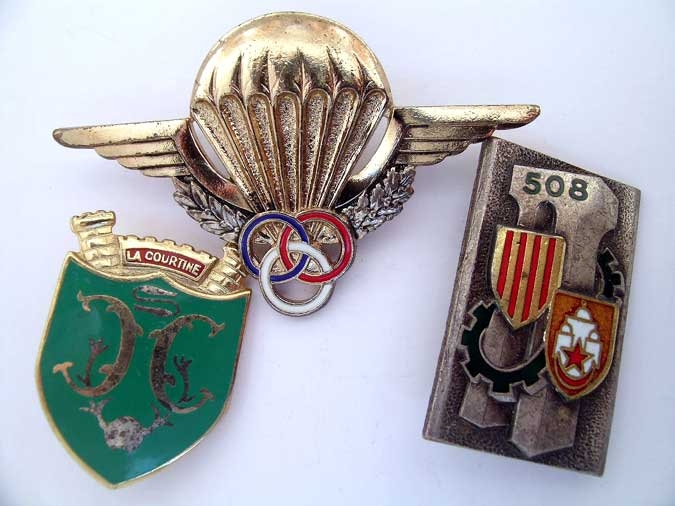 THREE BADGES