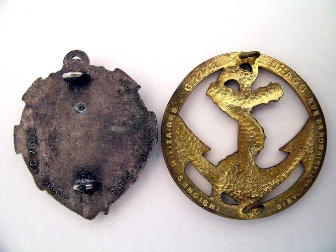 TWO NAVAL BADGES