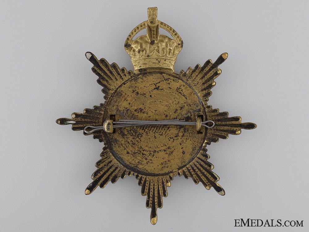A 1908 77th Canadian Infantry Helmet Plate; King's Crown
