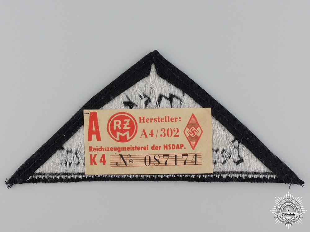 A BDM District Triangle Sleeve Badge with RZM Tag