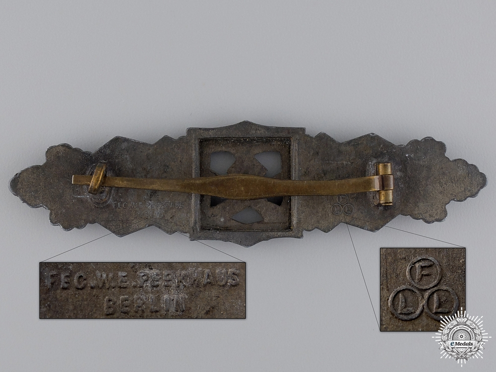 A Bronze Grade Close Combat Clasp by Fec. W.E.Peekhaus