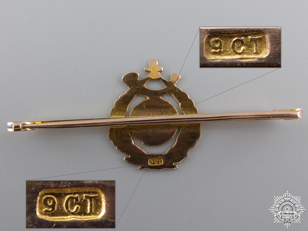 A British Royal Marine Light Infantry Pin in Gold