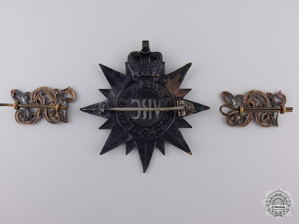 An 1862 3rd Battalion Victorian Rifles of Canada Cap Badge and Shoulder Pair