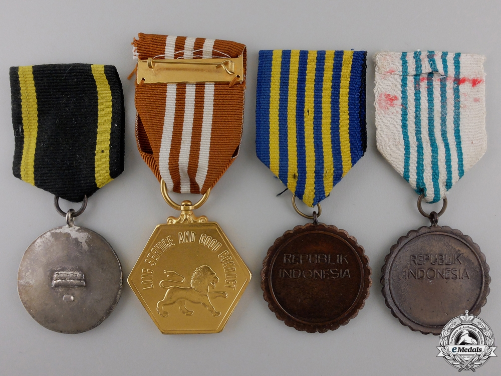 Four Medals from Indonesia & Singapore