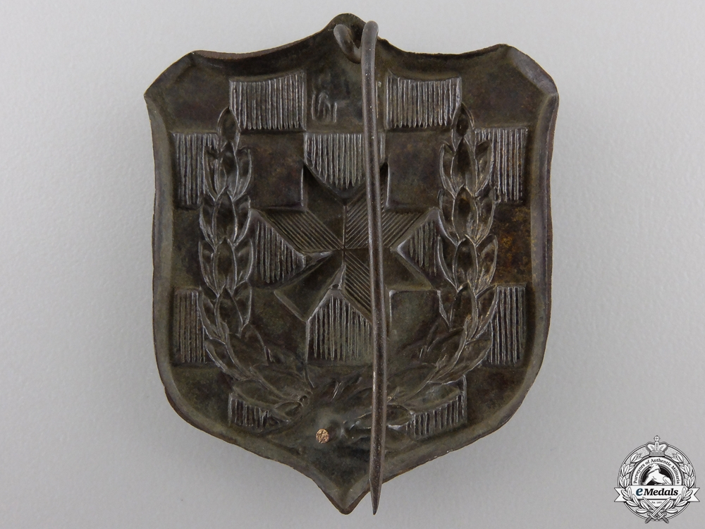 A 1943 Iron Trefoil Officers School Commemorative Badge