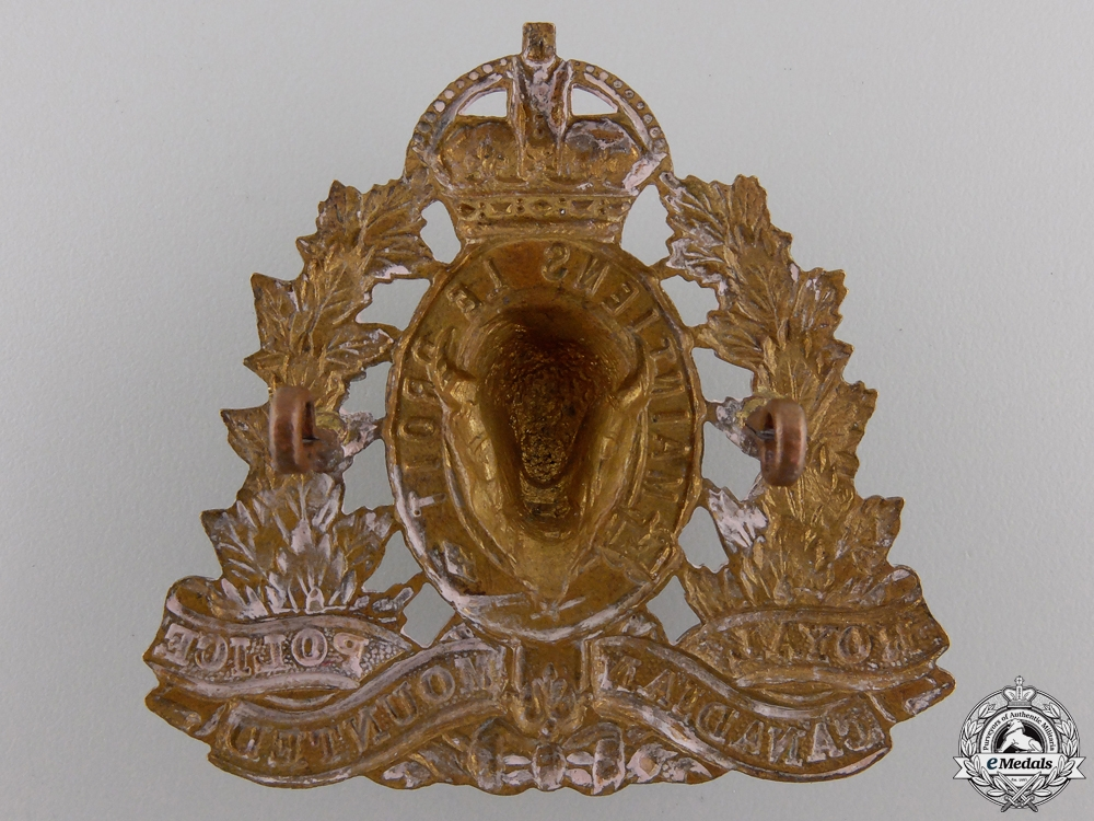 A Second War Royal Canadian Mounted Police Cap Badge