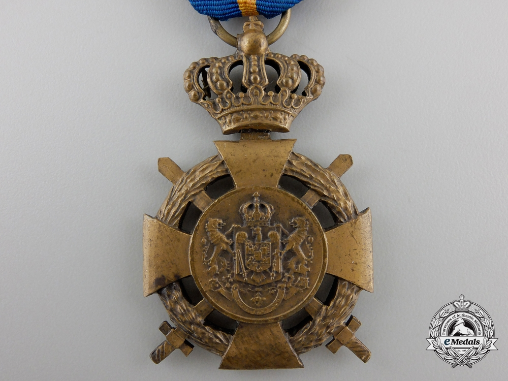 A Romanian Loyal Service Cross with Crossed Swords; 3rd Class