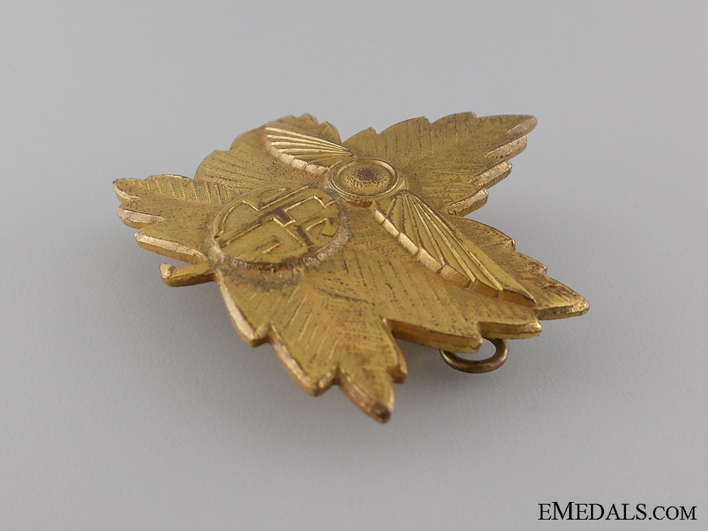 A Second War Elementary Flying School Cap Badge