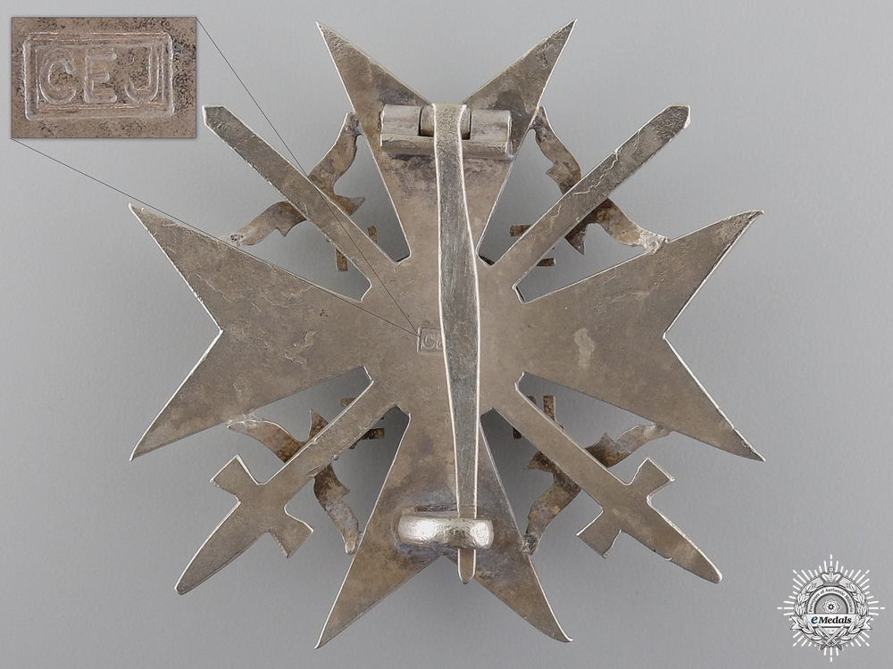 A Spanish Cross in Silver with Swords by C.E. Juncker