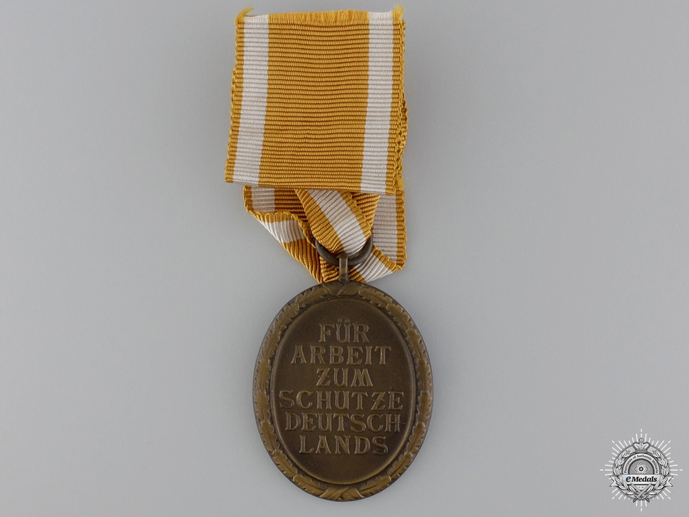 A Second War West Wall Medal & Award Document to the RAD