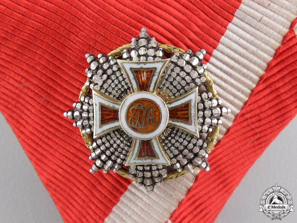 An Order of Leopold Knights Cross in Gold with War Decoration