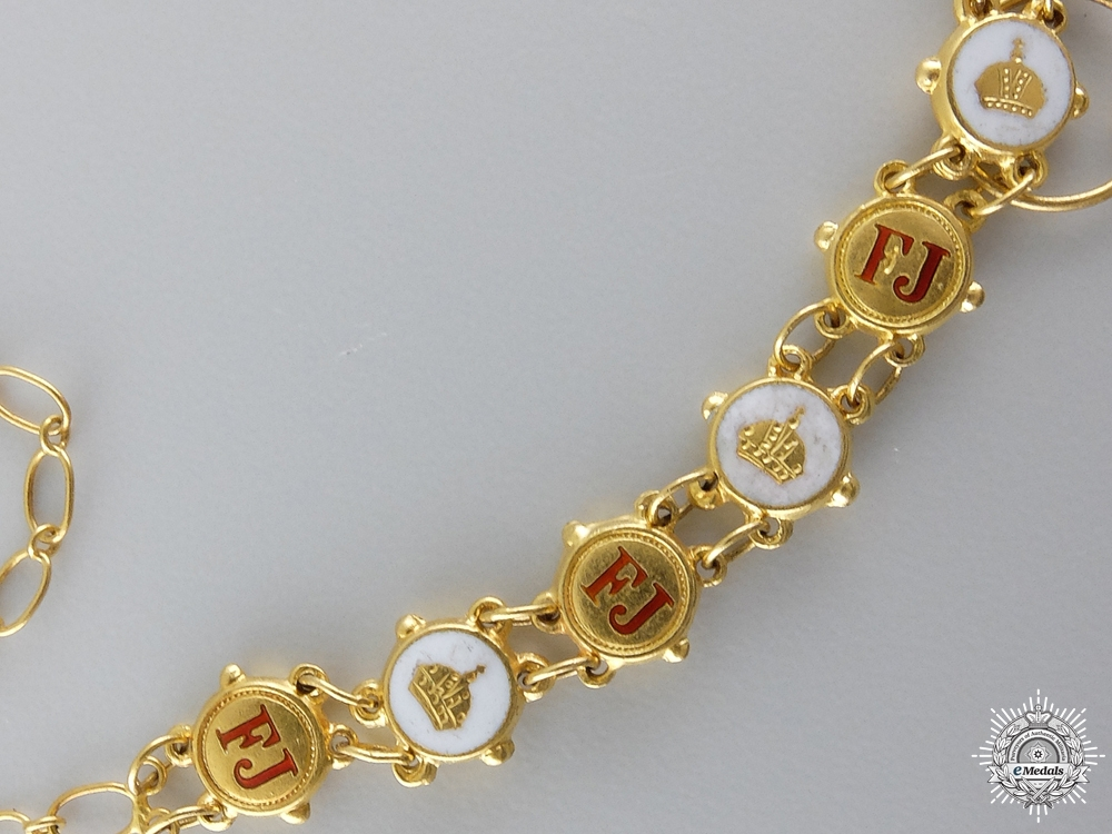 A Miniature Austrian order of Franz Joseph in Gold by R. Souval