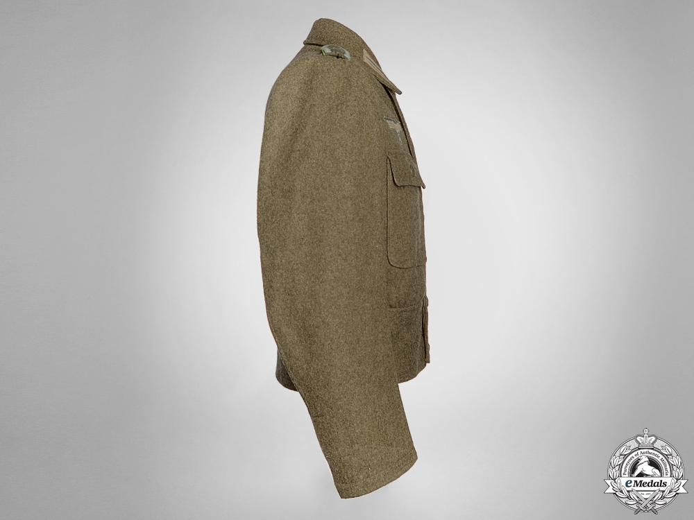 A German M44 Combat Tunic with Printed Eagle