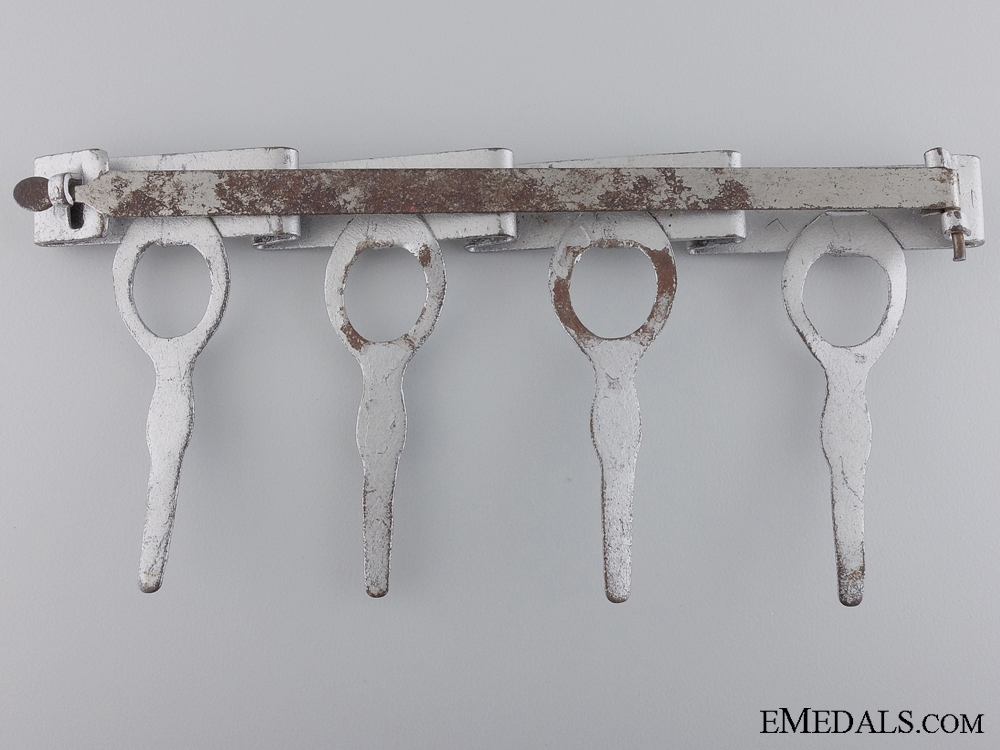 A Japanese Four Medal Suspension Bar with Carton