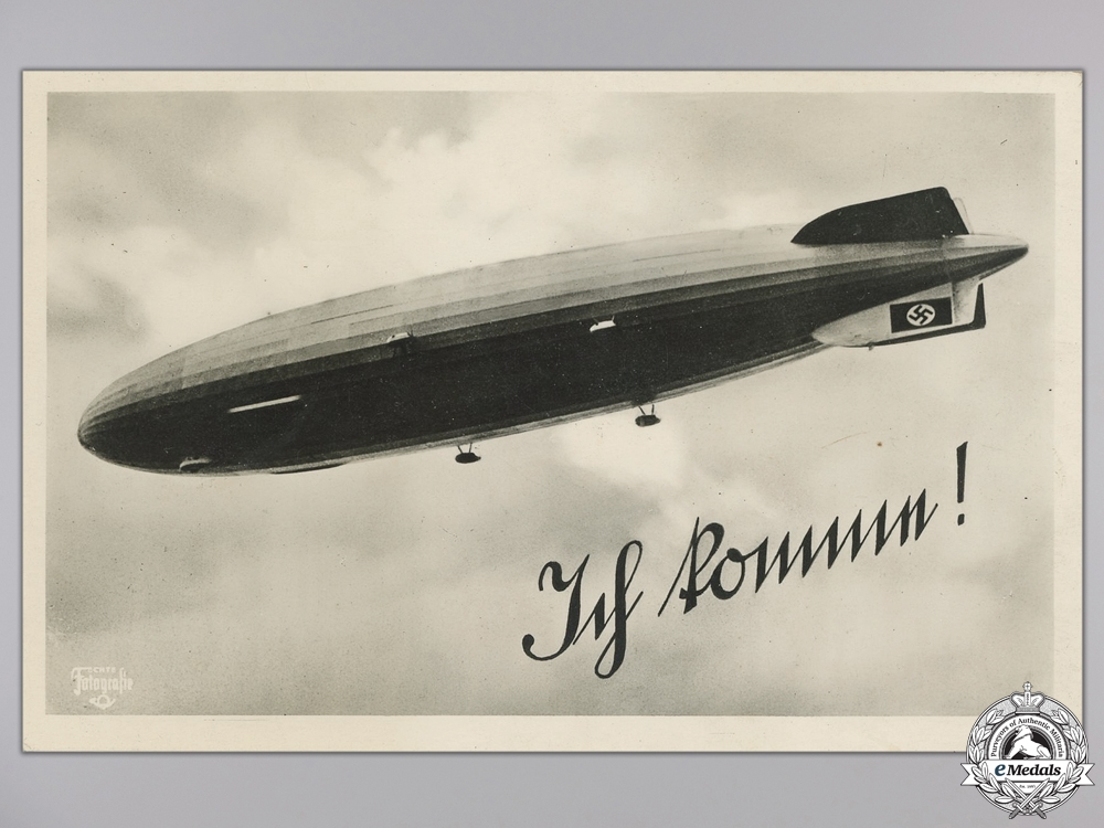 A 1925-30 Zeppelin Badge and a Postcard