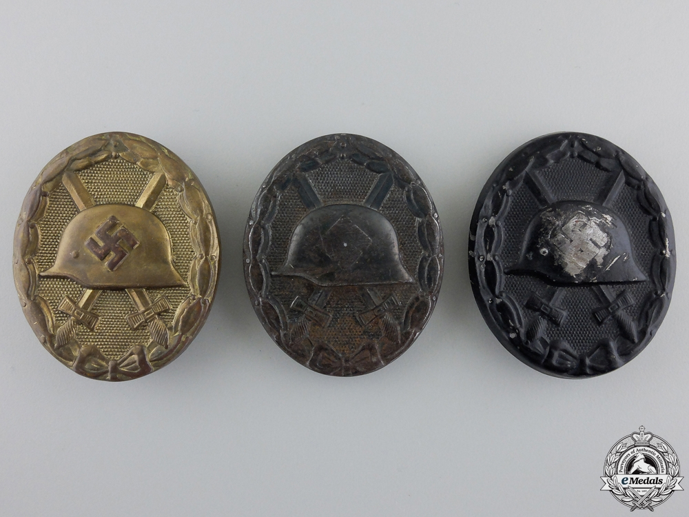 Three Second War Black Grade Wound Badges