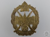 A WWII Mount St. Louis College Canadian Officer Training Corps Cap Badge
