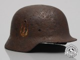 A Battlefield Recovered Single Decal SS M40 Helmet