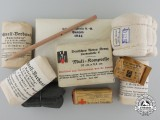 A Selection of Second War German Red Cross Bandage Packages and Pencil