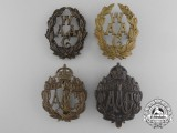 Four Woman's Auxiliary Army Corps Cap Badges