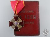 An Imperial Russian Order of St.Anne; Third Class Cross in Gold with Case