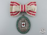 An Austrian Honour Decoration of the Red Cross; Silver Grade Medal with War Decoration, Ladies 1864-1914