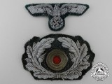 A German Army Officer Visor Wreath and Eagle Insignia