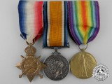 A First War Medal Trio to Private C.W. Foster; Northamptonshire Regiment