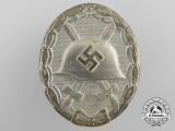 A 1939 Wound Badge Silver Grade by Hymmen & Co, Ludenscheid