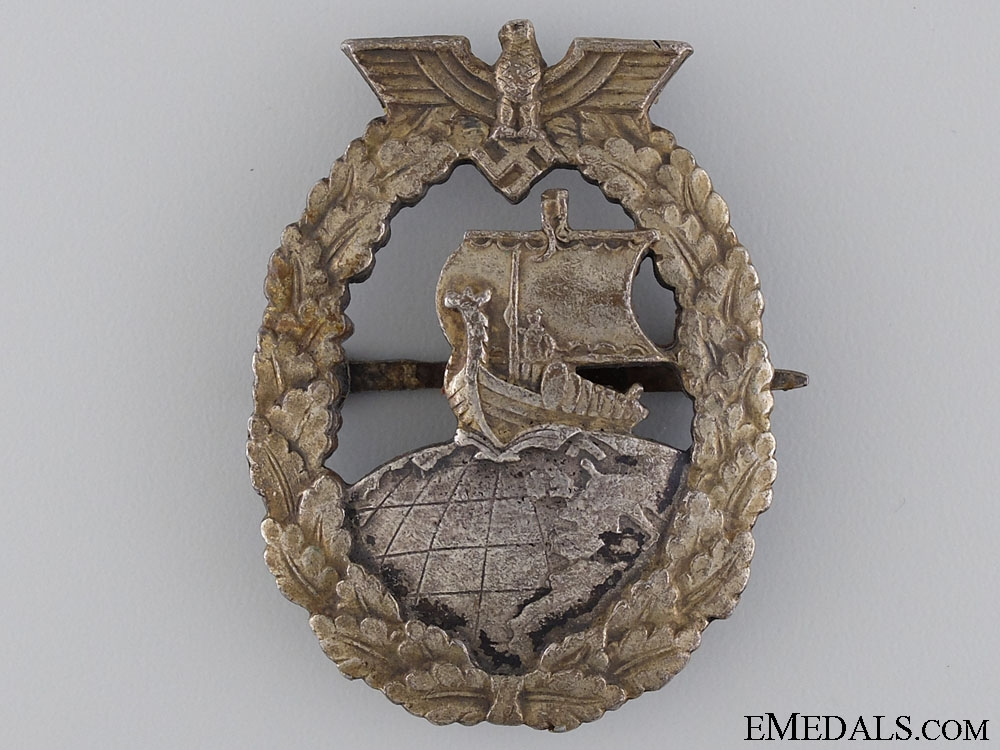 eMedals-A Kriegsmarine Auxiliary Cruiser War Badge by French Maker Bacqueville, Paris