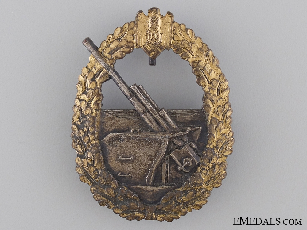 eMedals-A French Made Second War German Naval Coastal Artillery Badge