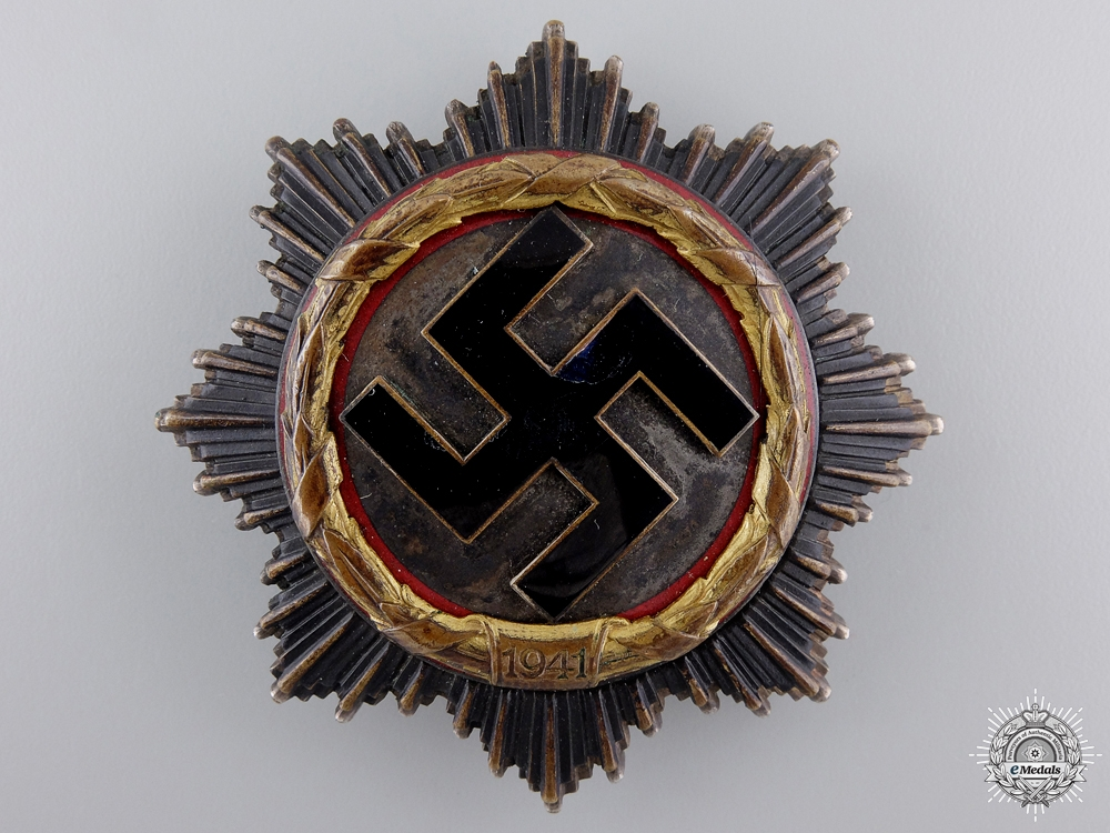 eMedals-A German Cross in Gold by Deschler & Sohn to Stuka Pilot Karl-Hermann Lion
