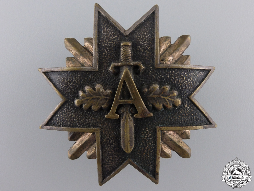 eMedals-A Pre Second War Latvian Military Badge with Swords