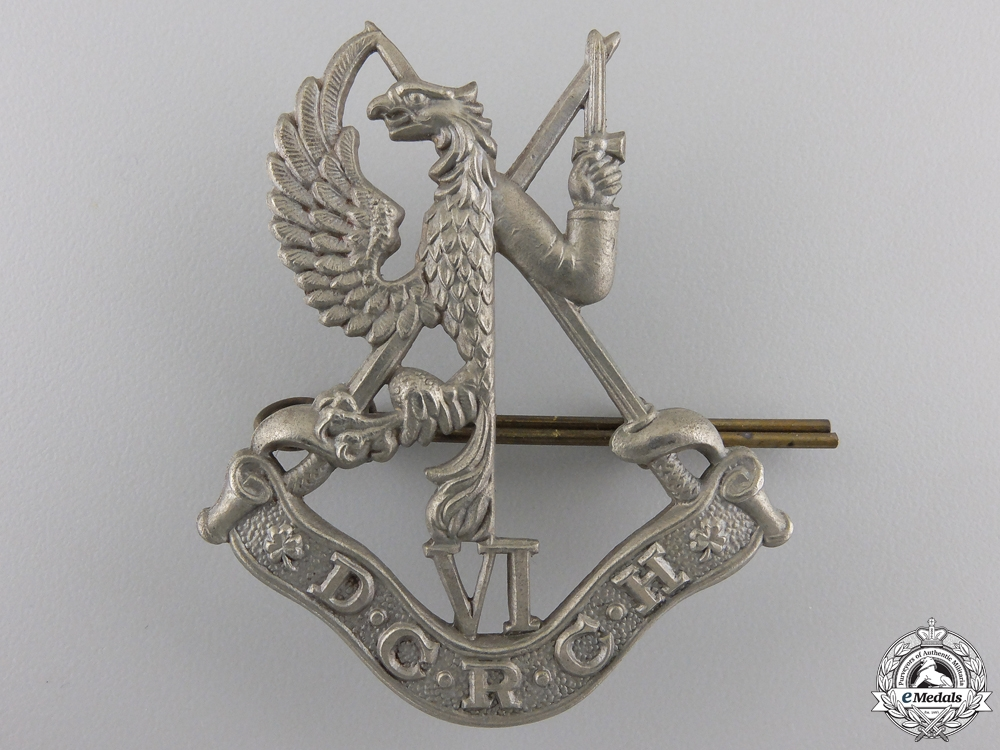 eMedals-A Second War 6th Duke of Connaught's Royal Canadian Hussars  Cap Badge