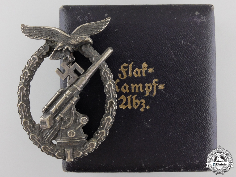 eMedals-An Early Cased Luftwaffe Flak Badge by C.E.Juncker