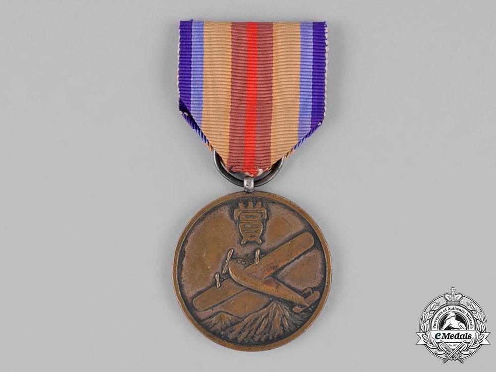 eMedals-Japan, Occupied Manchukuo. A Hsinking Flight Academy Association Merit Medal, c.1940