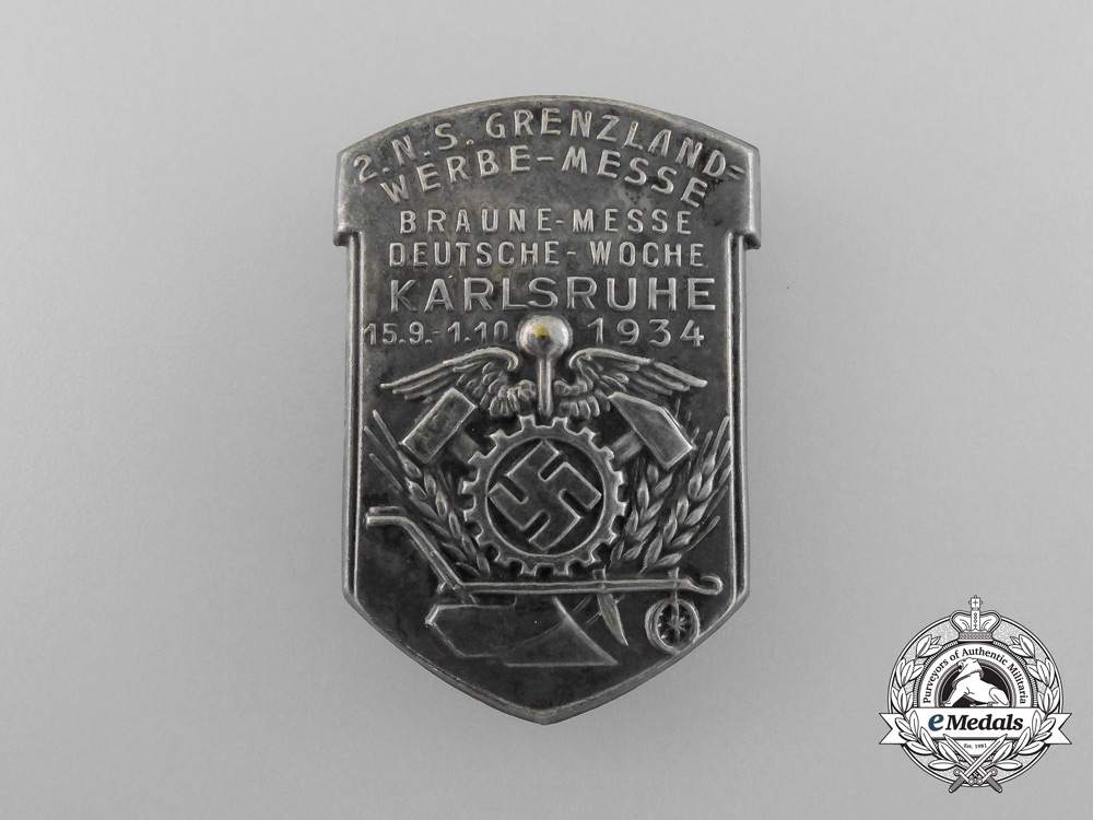 eMedals-Germany, Third Reich. A 1934 Karlsruhe Border-Counties Braune Messe Badge