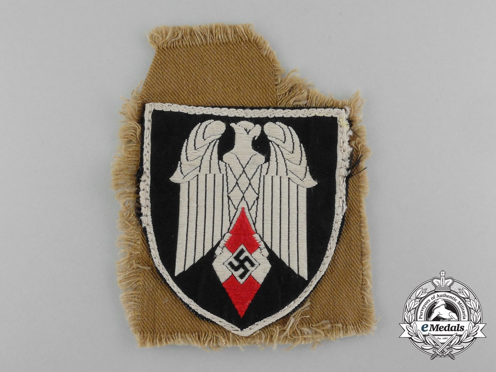eMedals-An Arm Badge for a Standard-Bearer of an HJ Gefolgschaft; With Section of Tunic